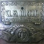 A mailbox near the elevators.
