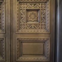 A Moorish star on the elevator doors.