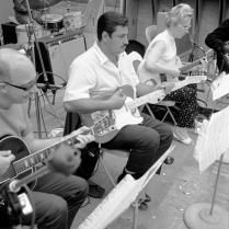 Guitarist Tommy Tedesco (center) with guitarist/bassist Carol Kaye (right)
