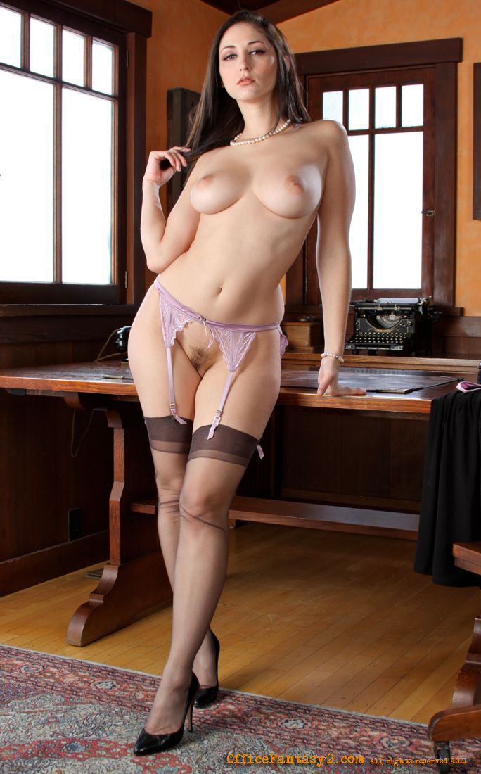 Sultry Nude Redhead In Grey Stockings