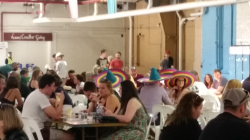 Beer drinkers engaging in some unconscionable cultural appropriation by wearing sombreros.