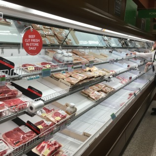 Not much meat on the shelves, but an employee arrived to restock it after I took this picture.